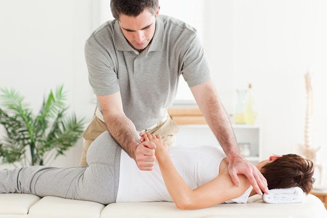 Chiropractor treating spine and joint.